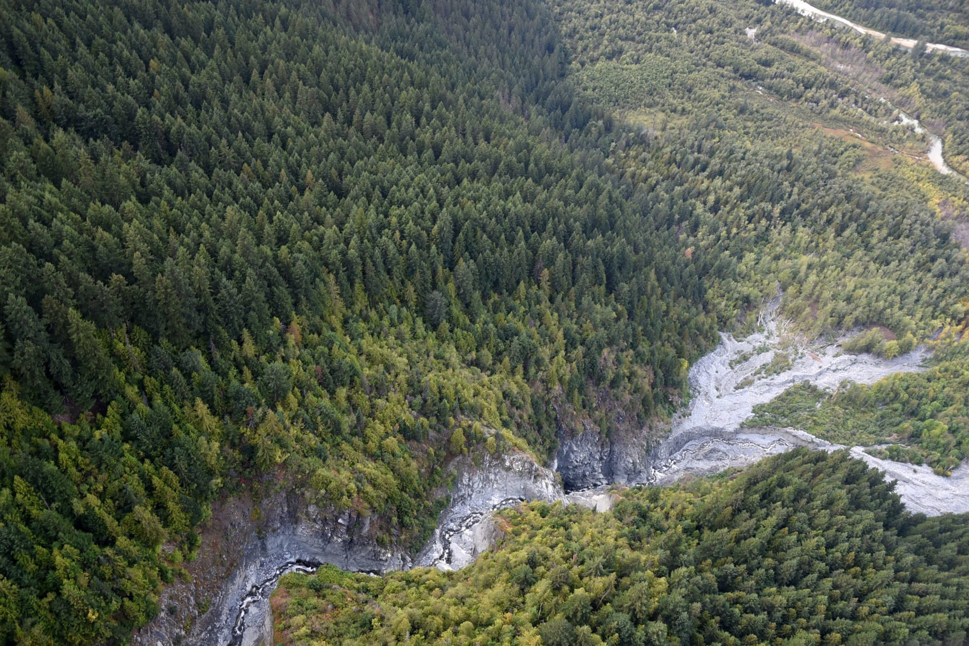 Active debris flowing through a river in the mountains