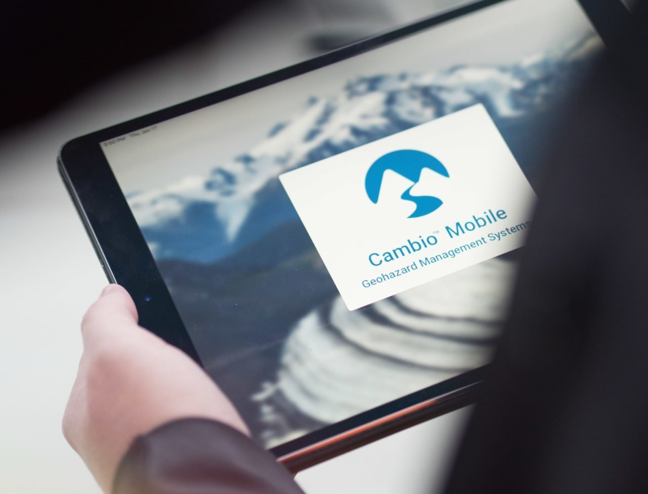 Person using Cambio Mobile application on an iPad